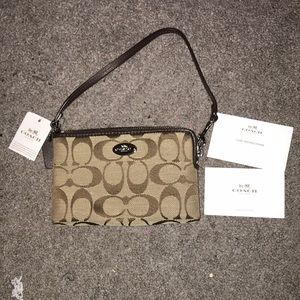 Coach wristlet, never used, tags all attached